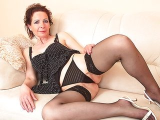 lustful delicate woman lying there in her undies touching herself