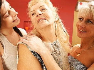 catch sight of this brunette gf with pierced tongue having enjoyment with two ladies