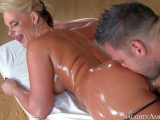 curvaceous milf fair-haired Phoenix Marie is with her face down on massage table as well as finds her waistband corset removed by revealing masseur. H