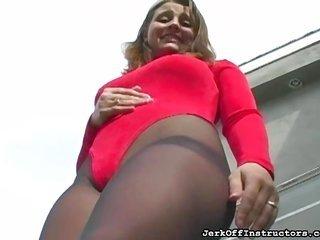 stimulating bosomy babe posing in pantyhose