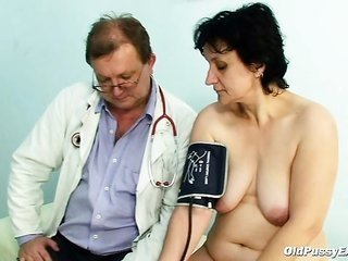 Old Miriam doctor gyno probe vagina checkup on gynochair