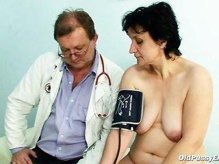 Old Miriam doctor gyno probe vagina checkup on gynochair