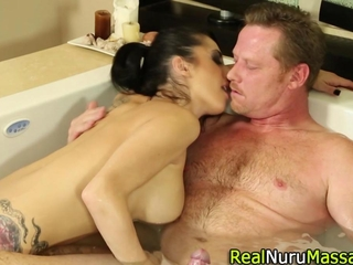 Tattooed playgirl blowing in the bathtub