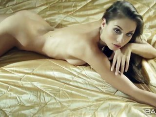 yummy fine chic Sabrisse enjoys relaxing naked on a daybed in addition to displaying her moving sexy body