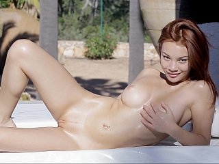marvelous redhead young woman doing herself